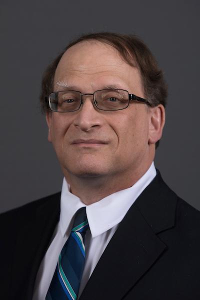 Visit Profile of Mark E. Schlesinger