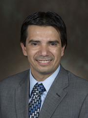 Visit Profile of Carlos Elias, M.M.